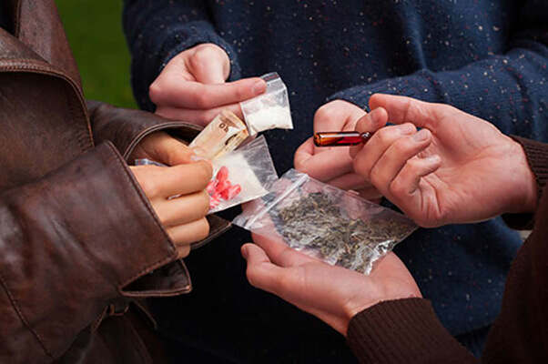 different types of party drugs being shared in a group
